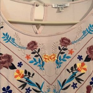 Cream tunic size Large with embroidered flowers.